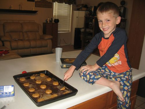 Jarom making cookies helping mom - small
