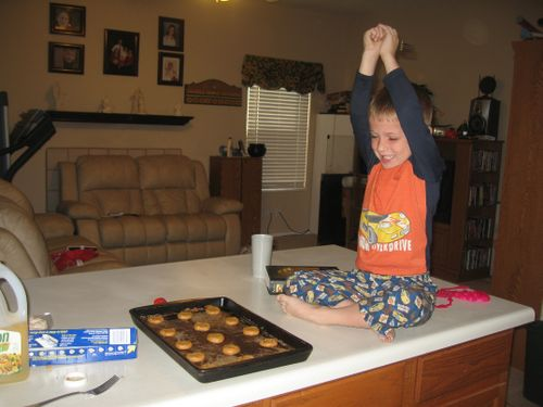 Jarom making peanut butter cookies - hiya! -small